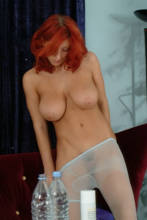 Redhead MILF Ashley Robbins shows off her large breasts in pantyhose 44658508