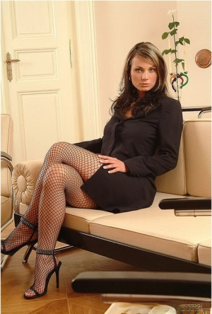 Sultry Katka in fishnet stockings spreading her bald pussy on her knees