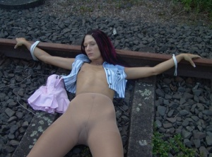 Amateur model is tied to railway tracks with her pantyhose pulled down 67117325