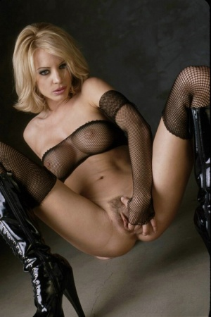 Hot blonde Nicoletta Blue toys her pussy in mesh attire and knee high boots 68755429