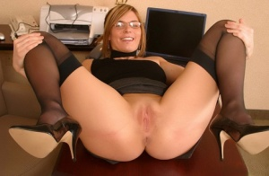 Hot secretary Cali showcases her bald cunt after hiking up her skirt
