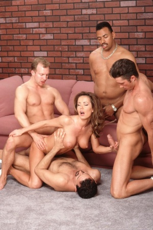 Busty MILF Envy sucks and rides multiple cocks in a wild gangbang