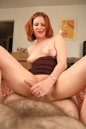 Redhead amateur Mina Gorey teases her man prior to POV sex on bed
