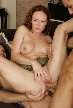 Redhead chick gets double fucked while her brunette girlfriend helps out