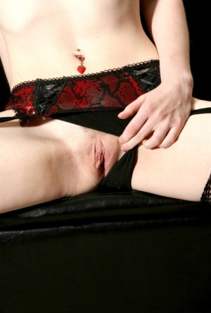Pale redhead Delila Rose slides panties aside to show her twat in fishnets 37781517
