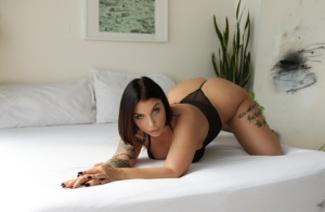 Busty chick with tattoos Ivy Lebelle tangles with two dicks at once on a bed 45960271
