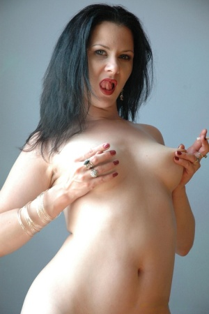 Brunette chick Mina smokes like a chimney while revealing her natural tits