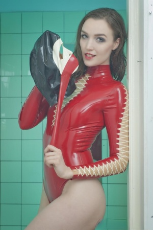 Brunette chick in latex bodysuit and high heels dons a rubber mask in bathroom 85373317