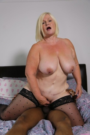 Blonde granny Lacey Starr gets banged on her bed by a younger black man 18689005