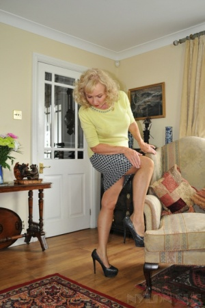 Mature lady Nylon Sue pulls down her bloomers after removing a miniskirt 58807927