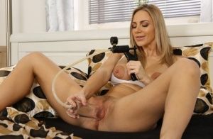 Long legged blonde Oprah masturbates with a toy after pumping up her pussy