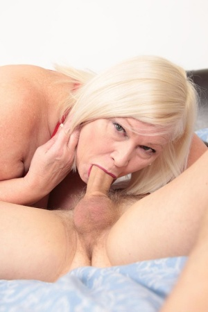Blonde UK granny Lacey Starr sucks the cum from a young mans cock after sex 75507152