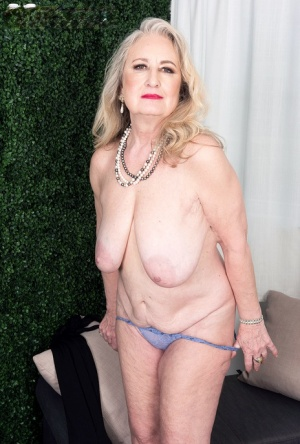 Sexy granny Blair Angeles uncovers her saggy tits while undressing 84049180