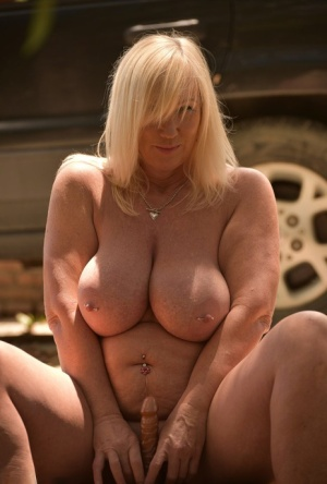 Big titted blonde Melody toys her vagina on the side of a driveway 58177015