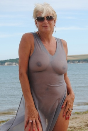 Mature platinum blonde Dimonty models at the beach in see through clothing 97636762