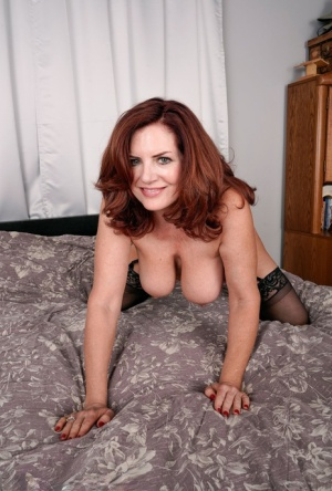 Over 30 redhead Andi James uncups her big tits prior to a finger fuck 54527043