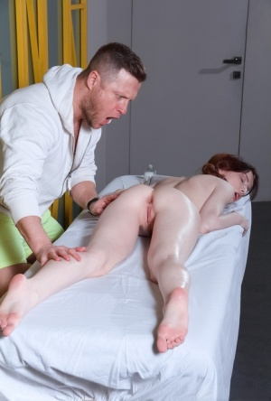 Young redhead Lottie Magne sucks off her masseur after anal sex 65607919