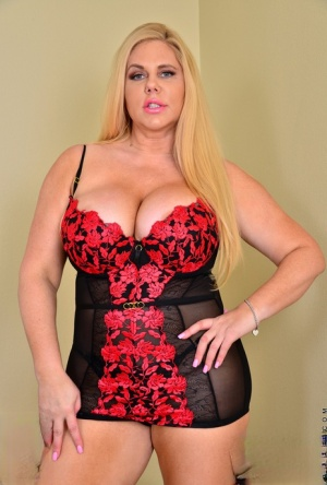 Thick older blonde Karen Fisher frees her big tits and snatch from lingerie