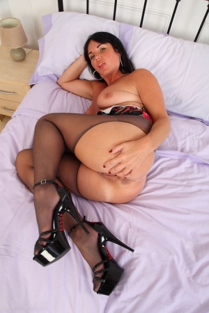 Dark haired amateur Leah rips open her pantyhose to display her vagina 64989280