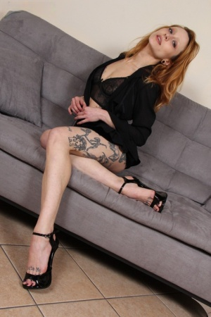 Tattooed redhead Stella shows the bottoms of her feet while getting naked 73367915