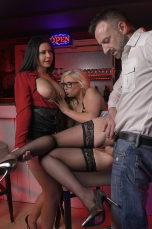 Blonde chick gets ass fucked in glasses while a brunette watches the action