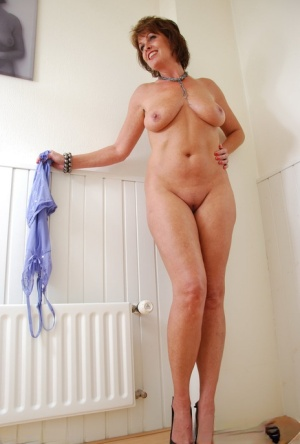 Mature amateur Luscious Models peels off mauve panties to model in the nude 16050216