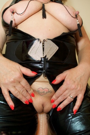 Thick amateur Dirty Doctor pleasures herself with a suction dildo in latex