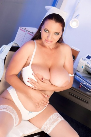 Thick nurse Joana Bliss sets her giant boobs free of a bra on a chair 23984690