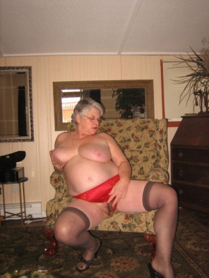 Old woman Girdle Goddess slips off red lingerie to get naked in stockings