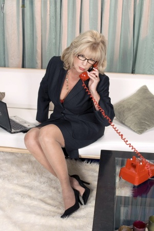 Blonde granny Anneke Nordstrum gets off the phone before sex with a young man 32039139