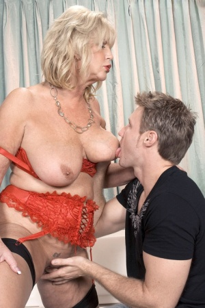 Blonde granny Anneke Nordstrum gets off the phone before sex with a young man