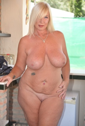 Older blonde Melody shows her large tits and big butt on a patio 58346826