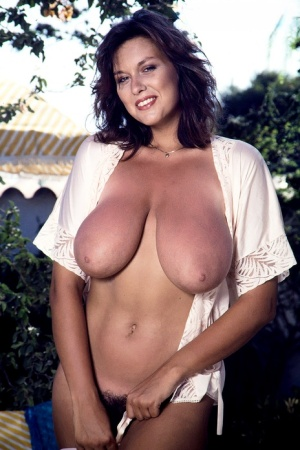 UK girl Jeannine Oldfield shows her muff after loosing her knockers on a patio