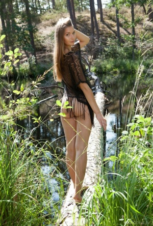 Jana solo model Ieva gets totally naked next to a body of water