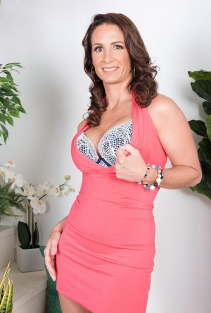 Middle-aged housewife Eliza Kelay stands naked after completely undressing