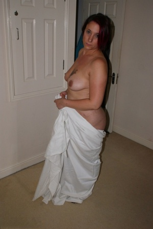 Overweight redhead models completely naked while in her bedroom 91558482
