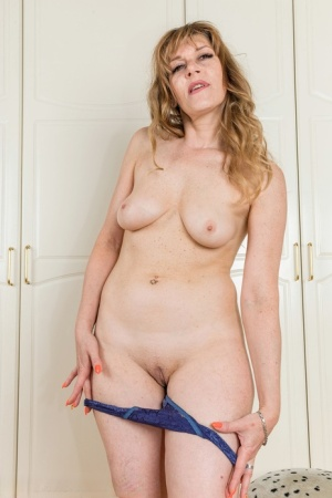 Over 30 British woman Scarlet Rose strips to her birthday suit near a closet 27755225