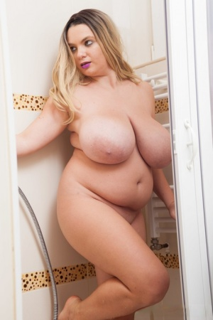 Blonde BBW Cute Kitty shows her huge tits while wetting her cunt in a shower 34531686
