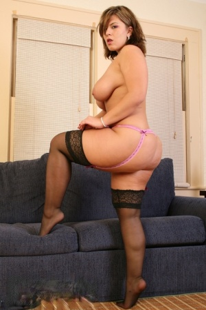 Amateur BBW Heavenly Smut holds her large tits before getting totally naked 52336564