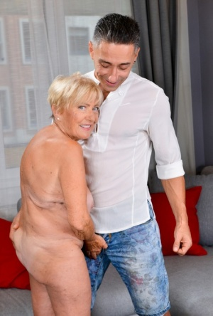 Older blonde woman Malya sticks her tongue out for cum after sex