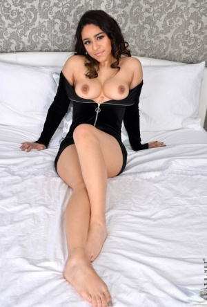 Young Indian girl Zoodie unzips a black dress get naked on top of her bed