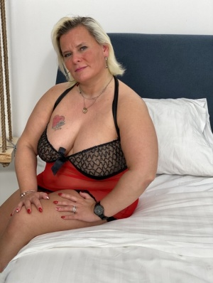Mature blonde fatty masturbates on her bed with a sex toy 18788819