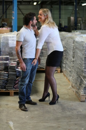 Tall blonde secretary bangs a worker amid pallets in a warehouse 34196996