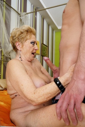 Old woman with short hair gets fucked on her bed by a much younger guy 34375723