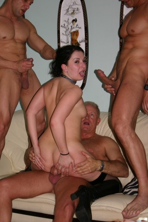 White slut wears a choker and leather boots during a gangbang
