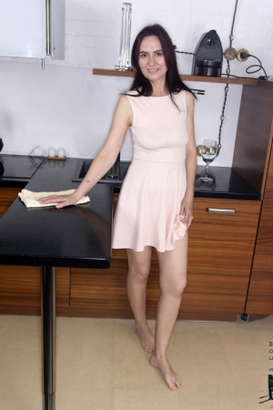 Brunette housewife Lira Red makes her nude debut while in the kitchen