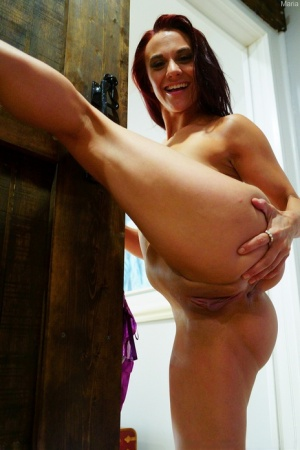 Amateur redhead Maria poses nude on a kitchen counter before masturbating 90003522
