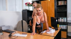 Big titted older blonde seduces a younger man during a job interview