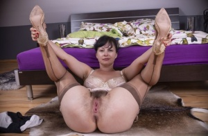 Busty older lady Nikita finger spreads her all natural pussy in the nude