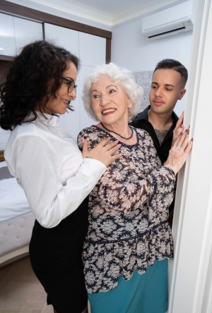 Kinky granny takes part in a threesome with a younger couple